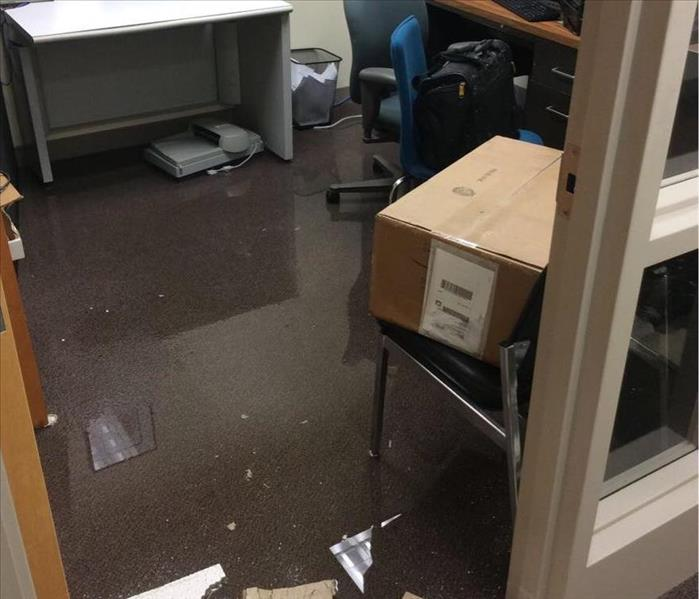 Flooded office space, standing water and debris