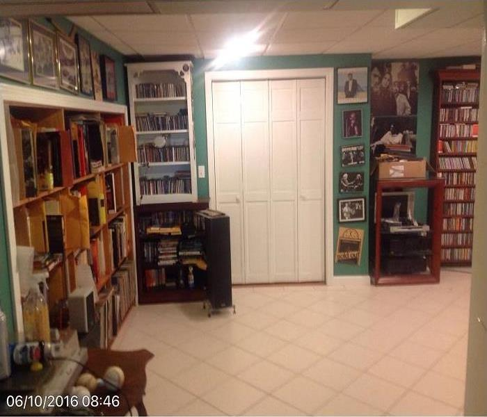Clea, bright organized basement interior