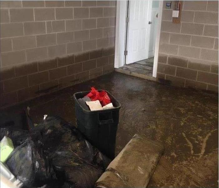 Flooded basement room with cinder block walls