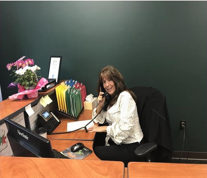 Smiling receptionist, ready to answer phone