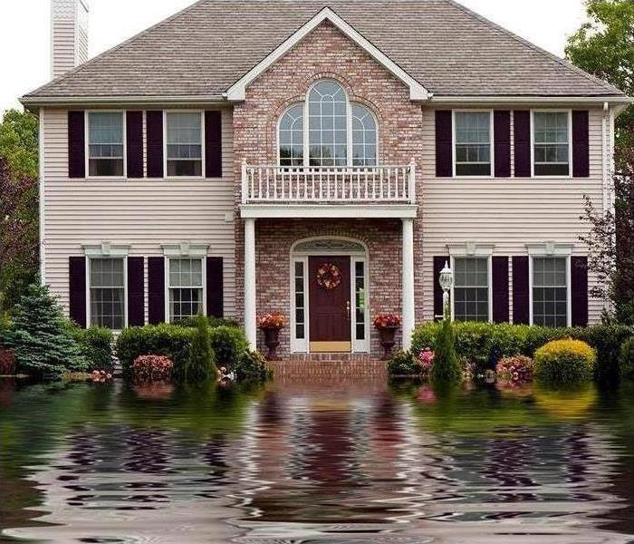 A home with major flood water in front yard