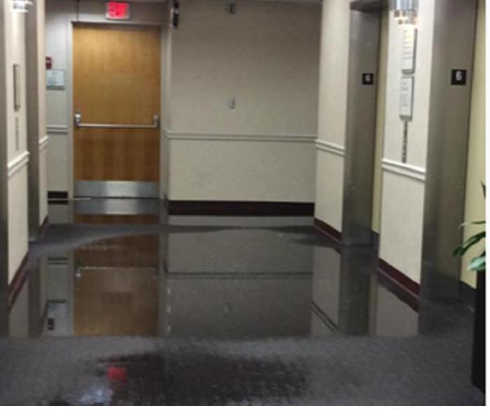 Flooded hallway in commercial environemnt